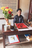 Local man does calligraphy in Ngoc Son Pagoda, a Buddhist temple at Hoan Kiem Lake.