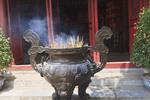 Incense offering at Ngoc Son Pagoda, a Buddhist temple at Hoan Kiem Lake.