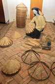 Display demonstrating how the iconic Vietnamese cone hat is made ath Hanoi's Ethnology Museum.