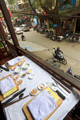 Table set for cooking class at Cafe Anh Tuyet in the old quarter of Hanoi, Vietnam.