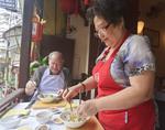 Celebrity chef Madam Pham Thi Tuyet shows student how to make