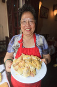 Celebrity chef Madam Pham Thi Tuyet with fresh made spring rolls in cooking class, Hanoi, Vietnam.