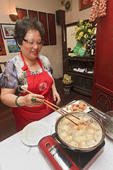 Celebrity chef Madam Pham Thi Tuyet cooks spring rolls in cooking class, Hanoi, Vietnam.