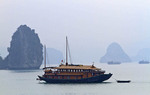 Traditional junk style boat carrying passengers in Ha Long Bay, Vietnam.