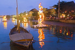 Floating decorations, lit at dusk on the Thu Bon River in Old Town, Hoi An,  Vietnam.