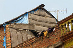 Rice paper (used in cooking) dries on bamboo racks hanging from house in Tho Ha village, near Hanoi, Vietnam.