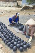 "Workers make ""bee hive"" coal in Tho Ha village, near Hanoi, Vietnam"