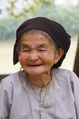 Elderly woman, 83, with smiling expressive face in Tho Ha village, near Hanoi, Vietnam.