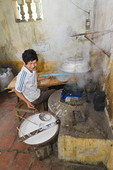Man shows how he makes rice paper (for cooking) in the kitchen of his home, Tho Ha village, near Hanoi, Vietnam.