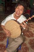 Man plays a stringed