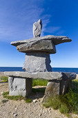 Inukshuk sitting on the beach of Hudson Bay in Churchill, Manitoba, Canada.