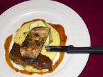 Kona coffee spice blend on blackened mahi mahi over creamy polenta along with braised short ribs