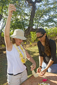 Learning how to string a lei with plumeria flowers on Molokai, Hawaii, USA.