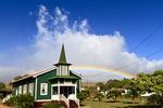 Rainbow behind a church on Molokai, Hawaii, USA.