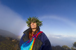 Barbara Bohonu, spiritual/cultural healer enjoying a rainbow shortly after sunrise at Haleakala Crater, Maui, Hawaii, USA.