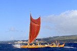Mo'olele, replica of an ancient Hawaiian war canoe, sails in waters off Maui, Hawaii, USA. This boat, whose name means Leapin Lizards, is 42 feet long and was built with twine and absolutely no metal according to traditional design. The twin canoe hulls were made with koa wood.