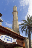 Muslim minaret seen next to a sign for a Jewish kosher market in Old Jaffa.