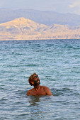 Bathers play in the salty waters of the Dead Sea in Israel.