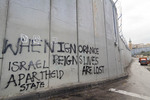 Graffiti on the security wall built to separate Jewish and Arab sectors of Israel.