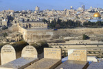 A view of Jewish tombstones looking out towards the old city of Jerusalem from the Mount of Olives, Israel.