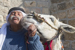 Bedouin Arab poses with his donkey at the Mount of Olives in Jerusalem, Israel.