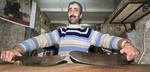 Arab man shows off his kebab knives which are 280 years old at his kebab shop in Jerusalem, Israel.