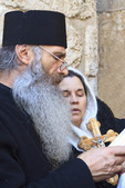 Greek Orthodox priest leads prayer at the Church of the Holy Sepulchre in the Old City of Jerusalem, Israel.