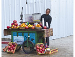 Arab man with his fruit cart outside the Old City of Jerusalem, Israel.