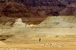 Man photographs Judaean (Judean) desert near Masada and the Dead Sea in Israel.