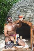 Maya Shaman greets visitors with ritual smoke from Copal resin.