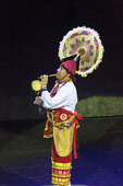 Man plays flute and drum as part of Danza de los Voladores (Dance of the Flyers at Xcaret's