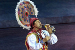 "Man plays flute and drum as part of Danza de los Voladores (Dance of the Flyers at Xcaret's ""Mexico Espectacular"""