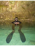 Scuba diver prepares to enter DreamGate, one of the many cenotes where people can scuba dive in Akumal, Yucatan, Mexico.