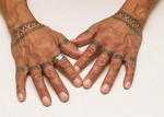 An Inuit woman's hands with traditional tattoos.