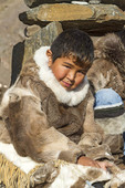 Young Inuit boy of Grise Fjord demonstrates traditional skin clothing.
