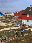 Local boys ride a bike and play at Ilulissat, Greenland