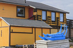 Colorful dogsled sits outside equally colorful house in Ilulissat, Greenland