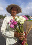Young woman selling lotus flowers outside the Royal Palace, Phnom Penh, Cambodia.