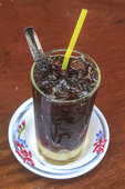 Cambodian style iced coffee with sweet condensed milk on the bottom.