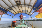 Boat driver on Mekong River, Kratie, Cambodia.
