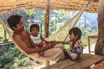 Young father and his daughters in a hammock, Kratie, Cambodia