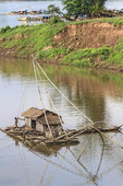 Floating Vietnamese houseboats on the Mekong River in Kratie, Cambodia.