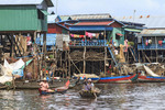 Women travel on small boats in Kompong Pluk, a village of stilt houses near Siem Reap, Cambodia.