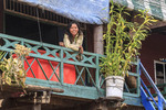 Woman on her deck in Kompong Pluk, a village of stilt houses near Siem Reap, Cambodia.