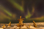 Northern lights seen over an Inukshuk (Inuit travel marker) on the shore of Hudson Bay in Churchill, Manitoba.