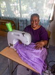 Seamstress working on hand made skirt for visitor to Kosrae, Micronesia.