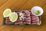Yellowfin tuna sashimi, fresh raw fish served Asian style with lime, raw onion and a dab of wasabi.