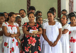 Micronesian women dressed in white lace sing four part choral harmony during church service in Tafunsak, Kosrae, Micronesia.