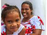 Mother and young daughter dressed in matching outfits for church in Tafunsak on Kosrae, Micronesia.