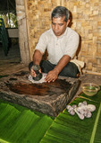 Kosrae man pounds cooked taro root, first step in making Kosrae dessert called 'fa fa.'